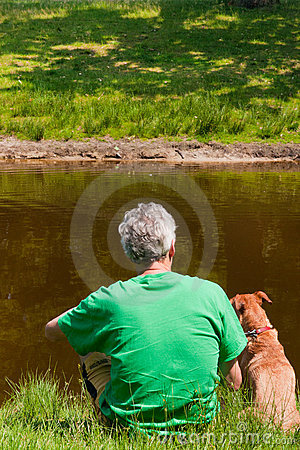 Man with his dog near the water