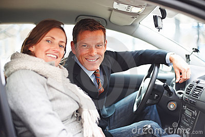 Man and his pretty wife sitting in a car