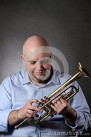 Man and his trumpet portrait