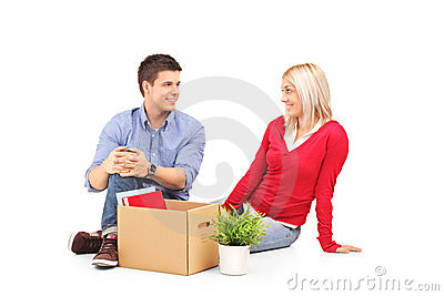 Man with his woman resting after moving