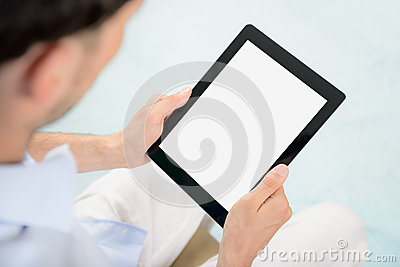 Man holding Apple iPad in hands