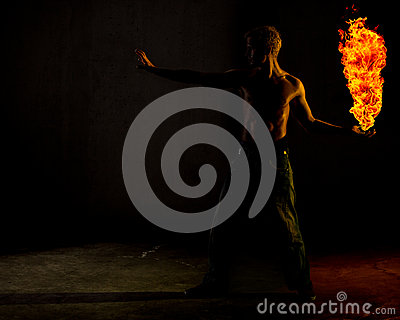 A man holding a ball of fire