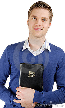 Man holding a bible showing commitment