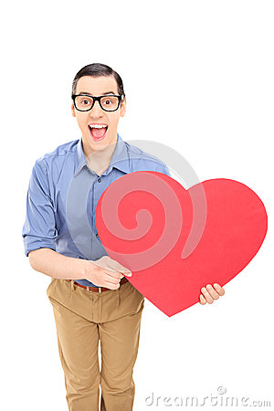 Man holding a big red heart
