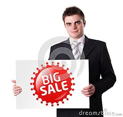 Man Holding BIG SALE sign