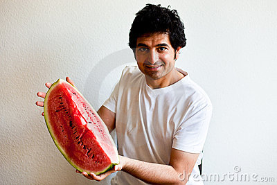 Man holding a  big slice of watermelon