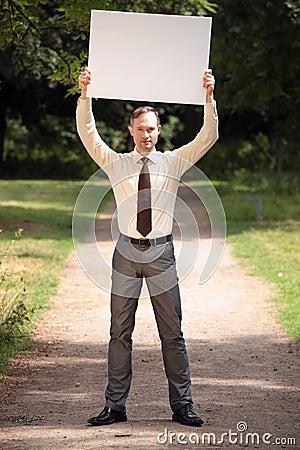 Man holding blank bulletin board