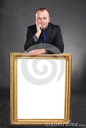 Man holding blank white card in frame
