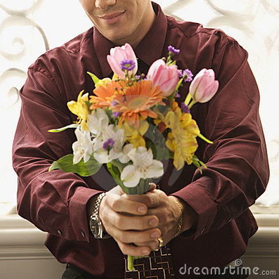 Man holding bouquet.