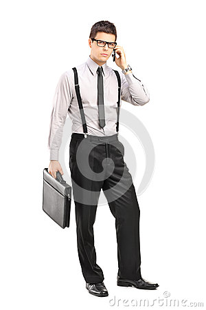Man holding a breifcase and talking on a mobile