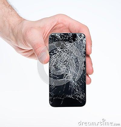 Free Man Holding Broken Smartphone Stock Image - 29486371