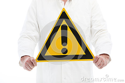 Man holding a caution sign with exclamation point