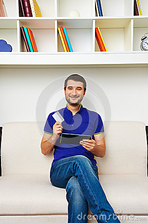 Man holding credit card and tablet pc