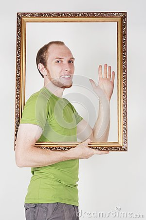 Man holding decorative picture frame