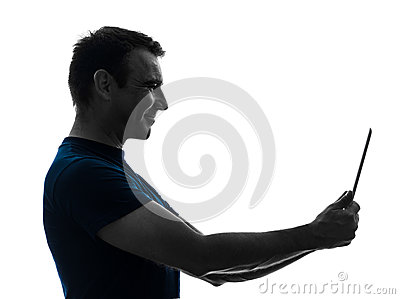 Man holding digital tablet  smiling silhouette