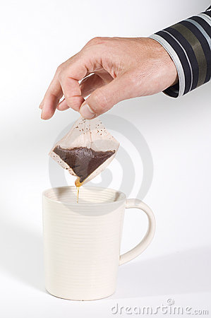 Man holding dripping teabag
