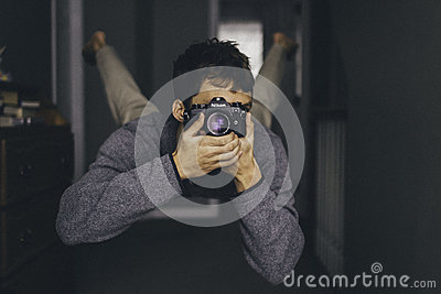 Man Holding Dslr Camera Wearing Gray Long Sleeves Shirt While Free Public Domain Cc0 Image
