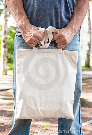 Free Man Holding Empty Canvas Bag. Template Mock Up Stock Photography - 75124422