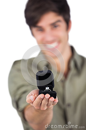 Man holding an engagement ring