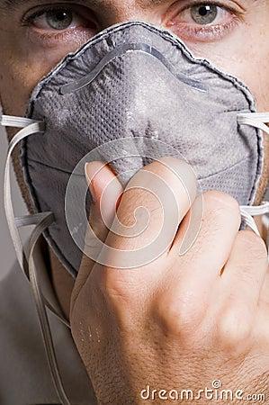 Man holding face mask