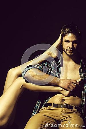 Free Man Holding Female Legs Stock Image - 122433721