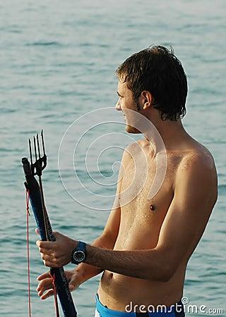 Free Man Holding Fishing Harpoon Royalty Free Stock Photo - 215755