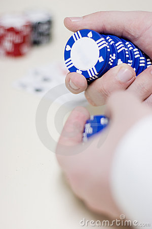 Man holding gambling chips
