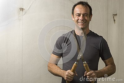 Man Holding Garden Shears - Horizontal