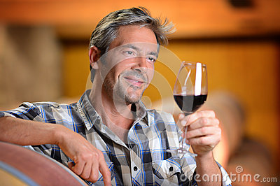 Man holding glass of wine