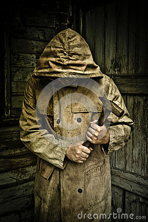 Man in raincoat holding hammer