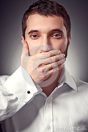 Man holding hand over his mouth