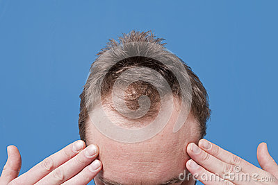 Man Holding Hands Up To Forehead Stock Photo - Image: 39038001
