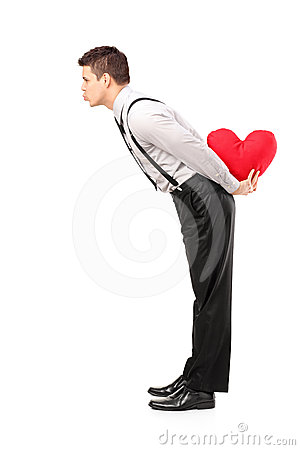 Man holding a heart and giving kisses