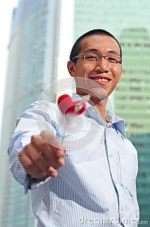 Man Holding A Heart Shape Stick