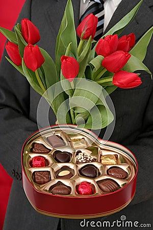 Free Man Holding Heart Shaped Box And Tulips Royalty Free Stock Photos - 461038