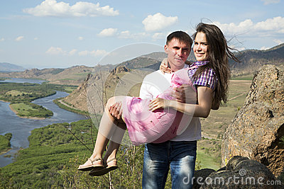 Man holding his girlfriend in his arms