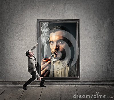 Man holding a huge picture