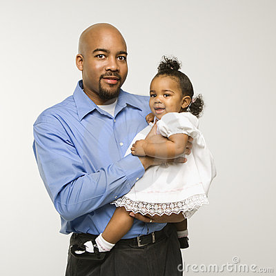 Man holding infant girl.