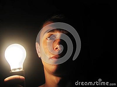 Man holding a lit bulb