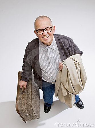 Man holding luggage and coat