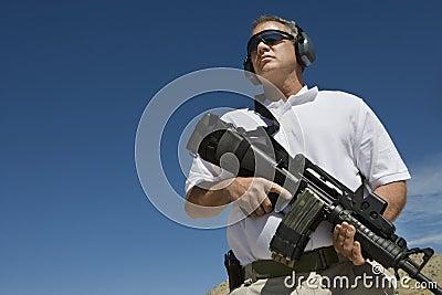 holding machine gun