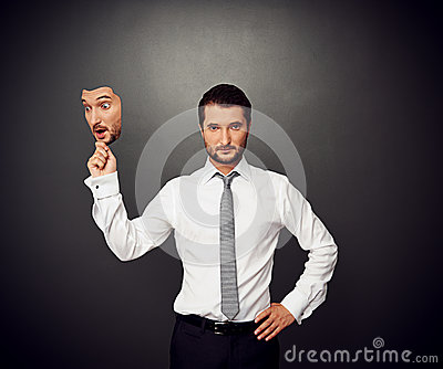 Man holding mask with amazed face