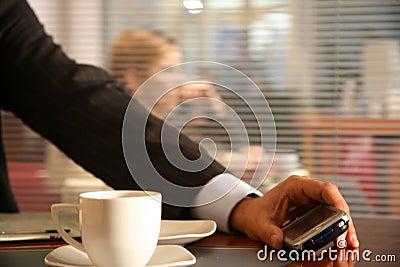 Man holding modern mobile phone - close up