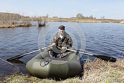 Man holding oars