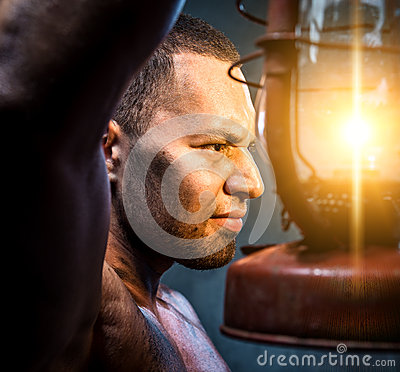 Man holding oil lamp