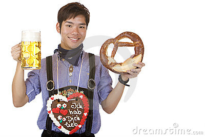 Man holding Oktoberfest beer stein and Pretzel