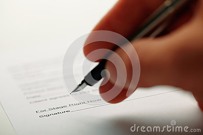 Man holding a pen while doing document.