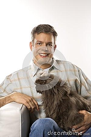 Man holding Persian cat.
