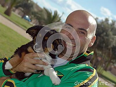 Man Holding Pet Dog