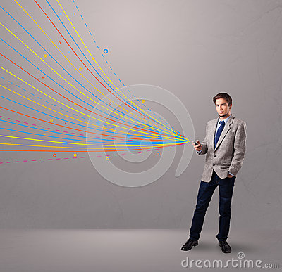 Man holding a phone with colorful abstract lines